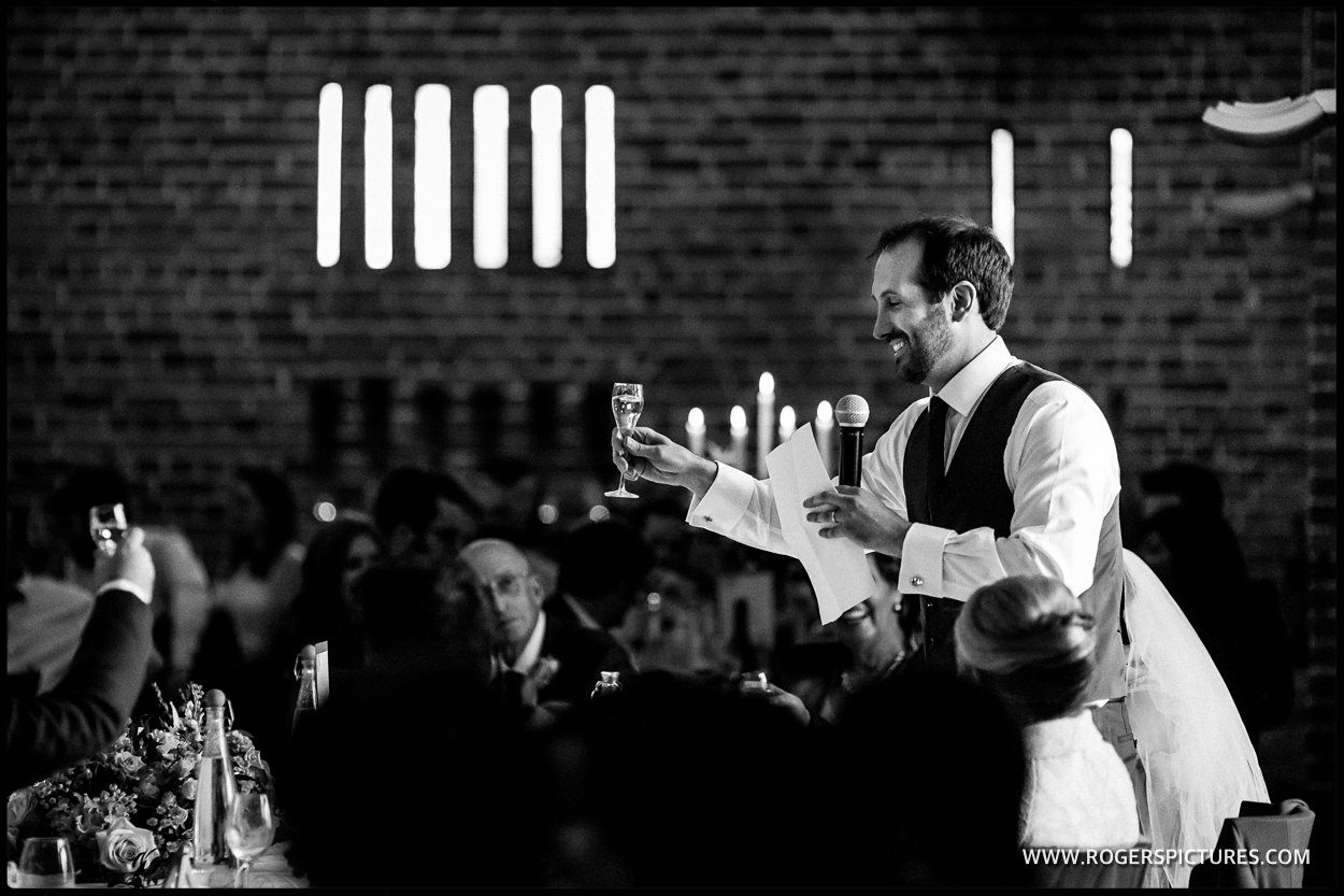 Groom toasting during his speech
