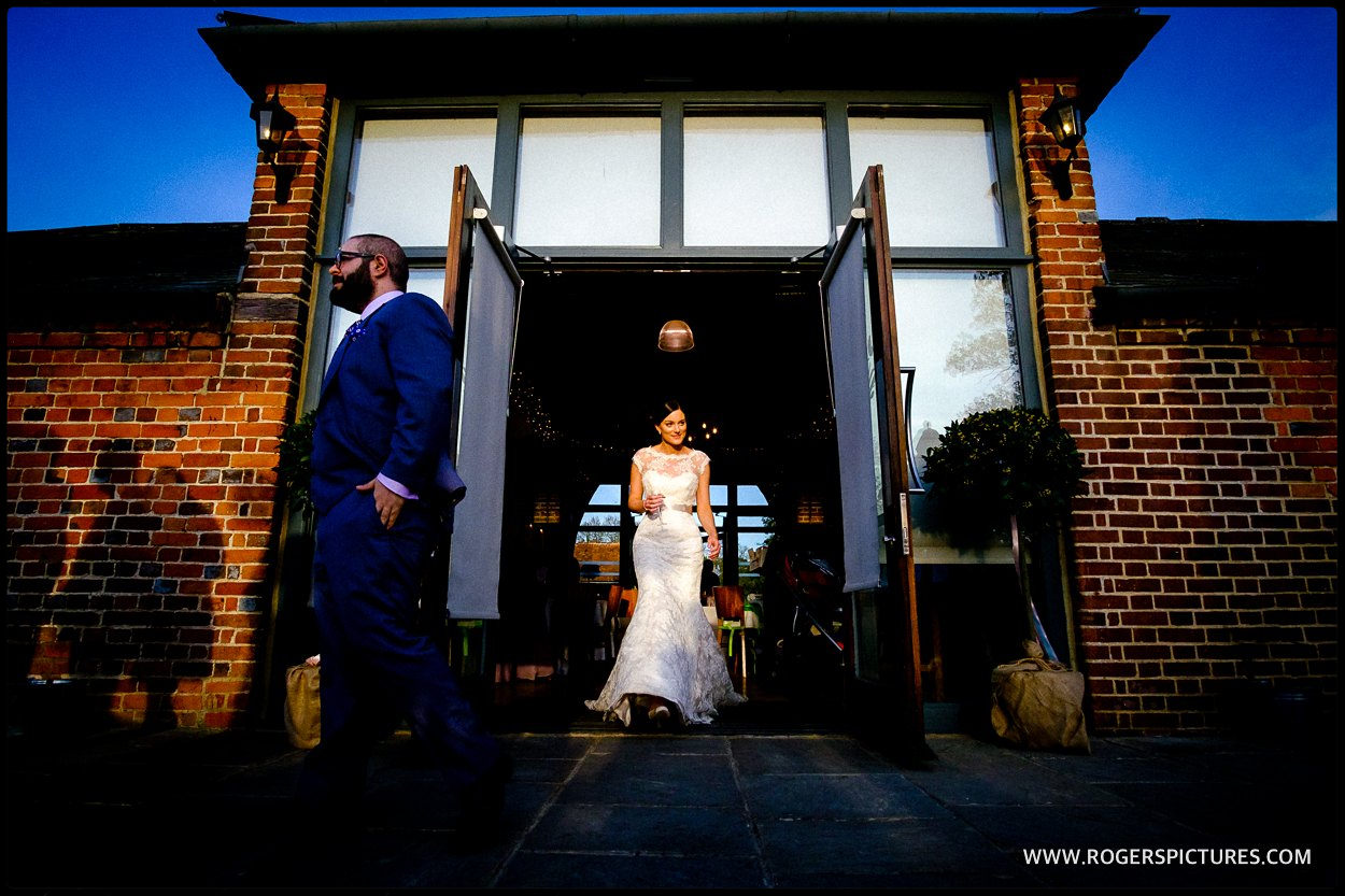 Bride walks out into the sunlight