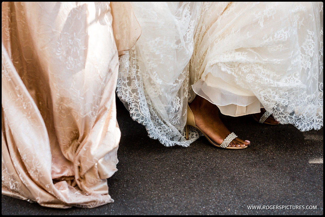 Detail of brides foot as she steps out of wedding car