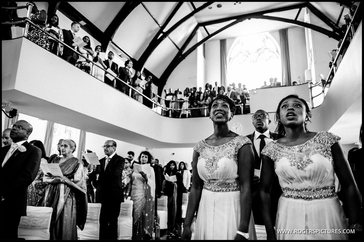 Black and white photo of the wedding ceremony at Kensington Temple
