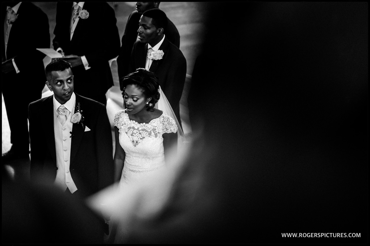 Black-and-white photo of bride and groom during the ceremony