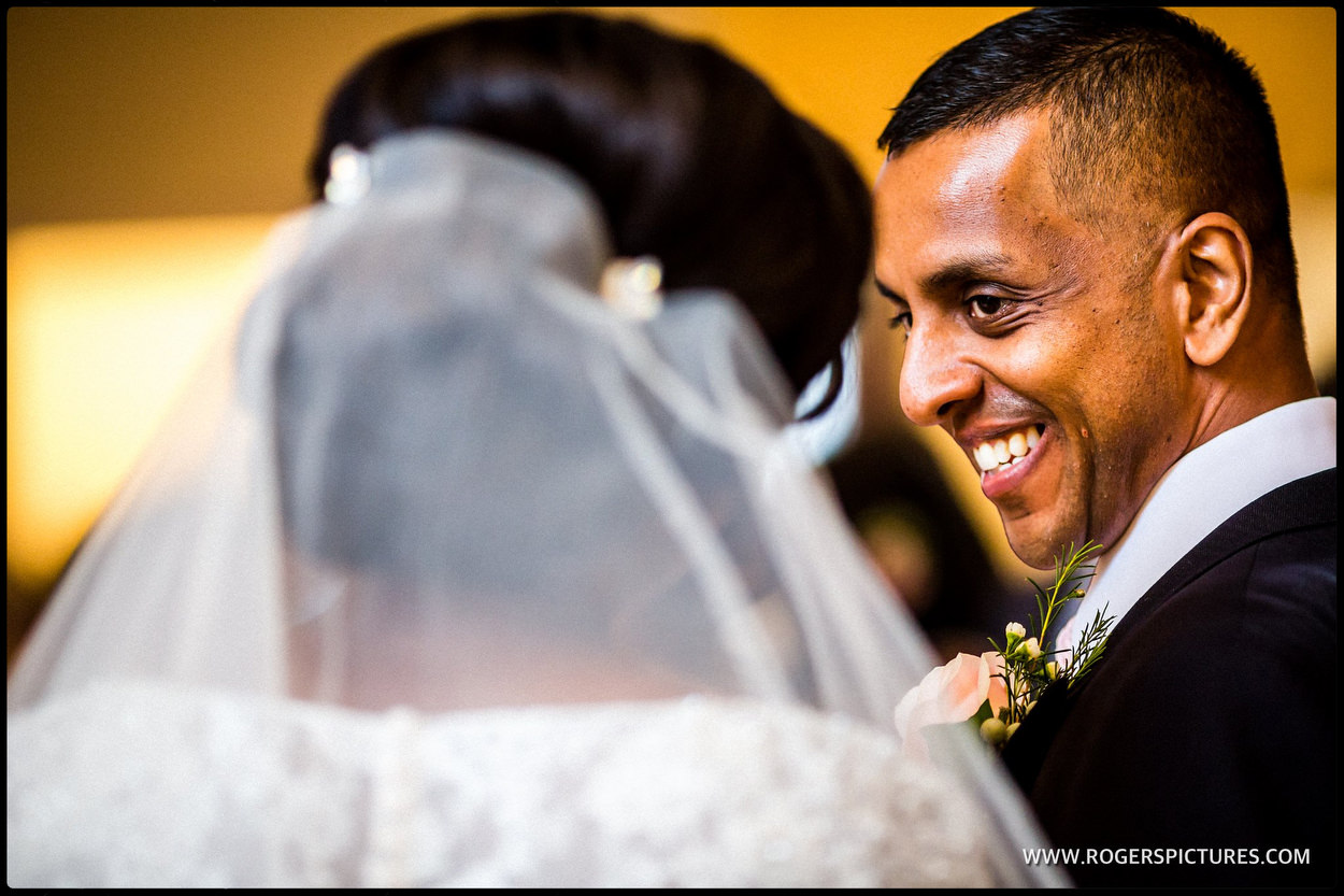 Smiling groom as he gets married