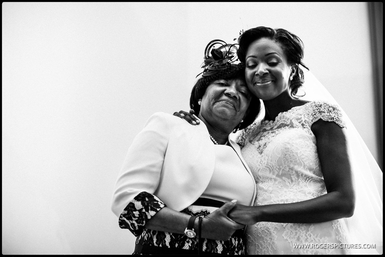 Mother and daughter embrace after a wedding at Kensington