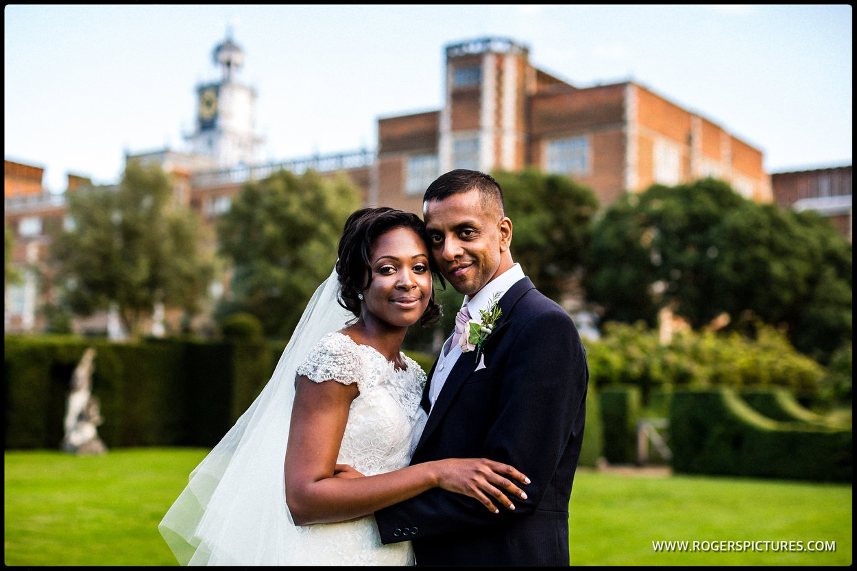 Bride and groom outside the old Palace at Hatfield house