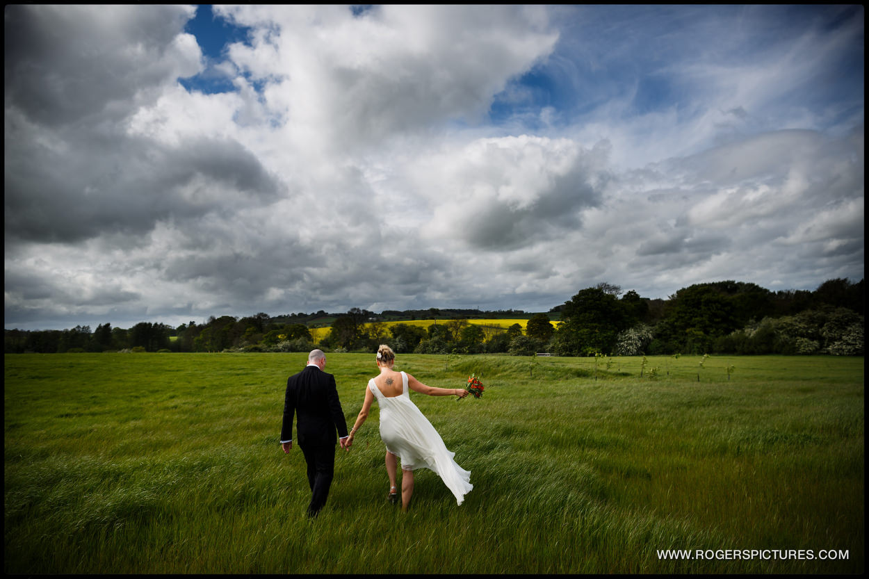 Couple in windy field at Dodford Manor in Northamptonshire
