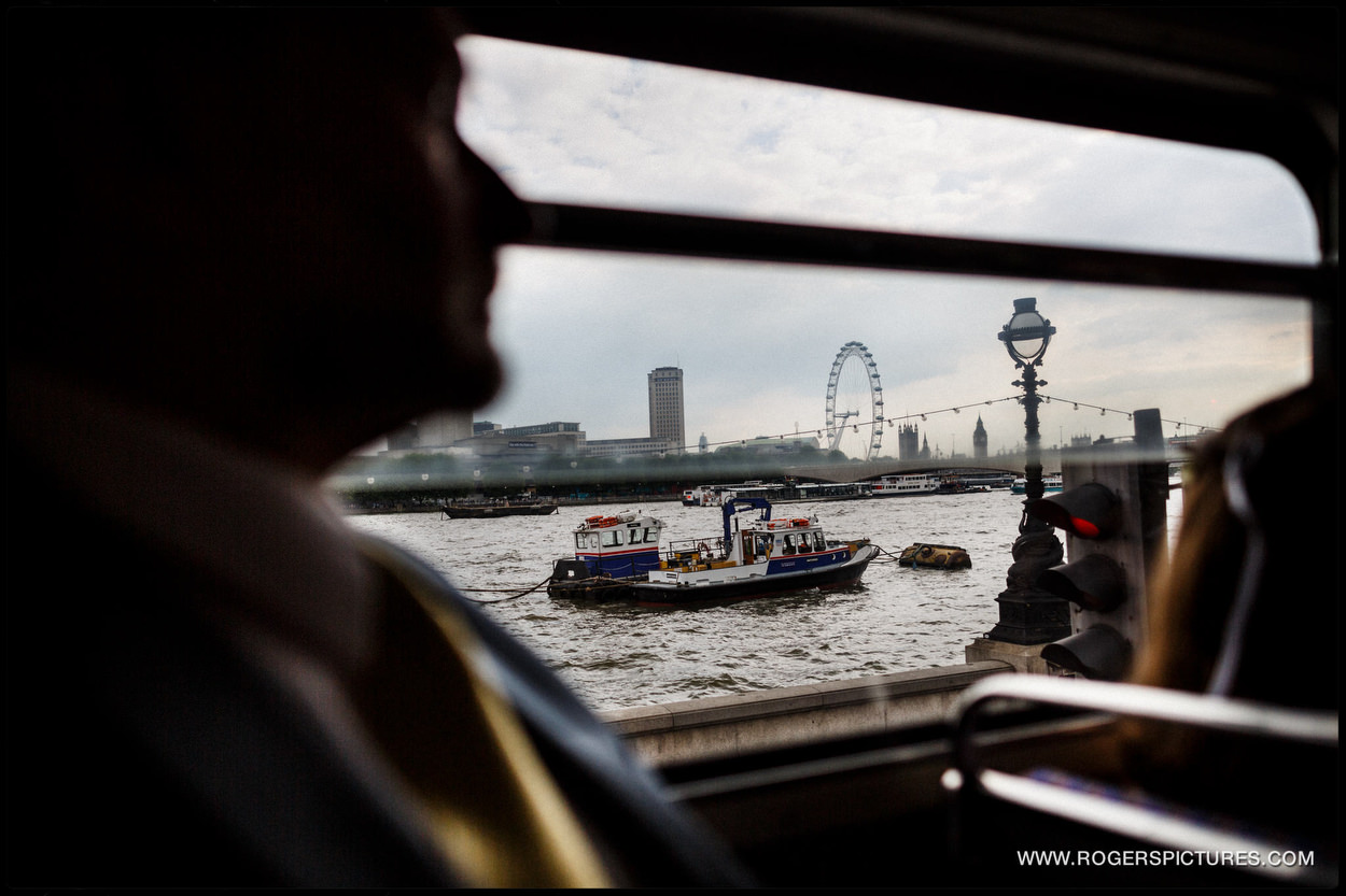 London Eye through a wedding bus