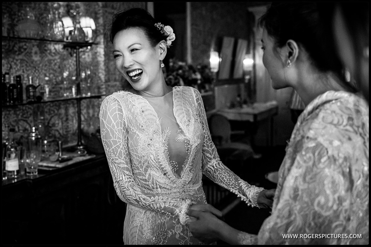 Black and white documentary photo of a laughing bride