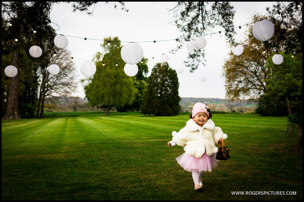 Small girl in pink dress at wedding