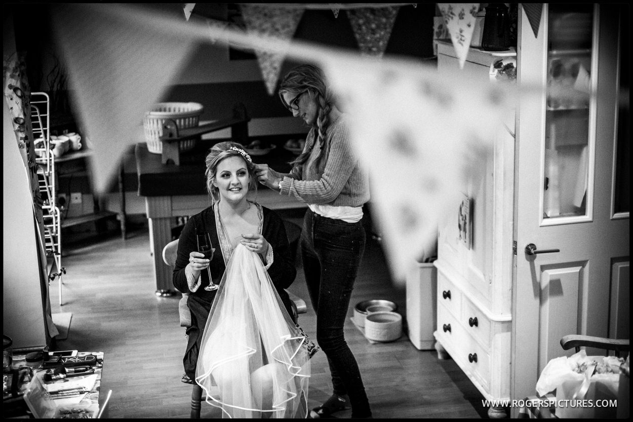 Bride preparation with a glass of champagne