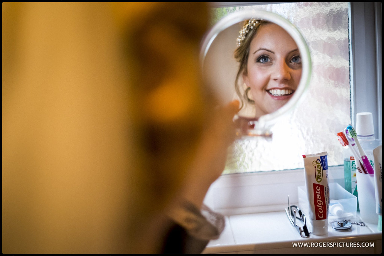 Brides reflection on the circular mirror