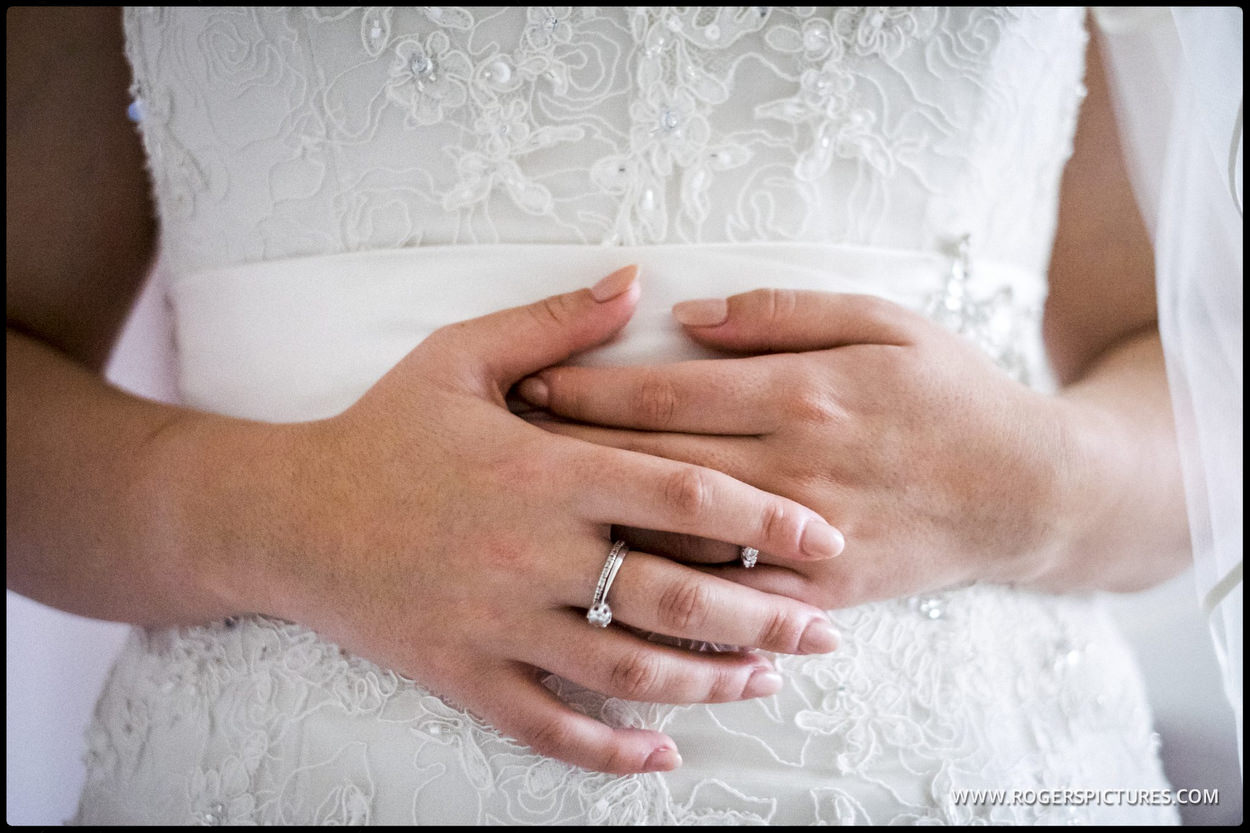 Bride clasps her hands