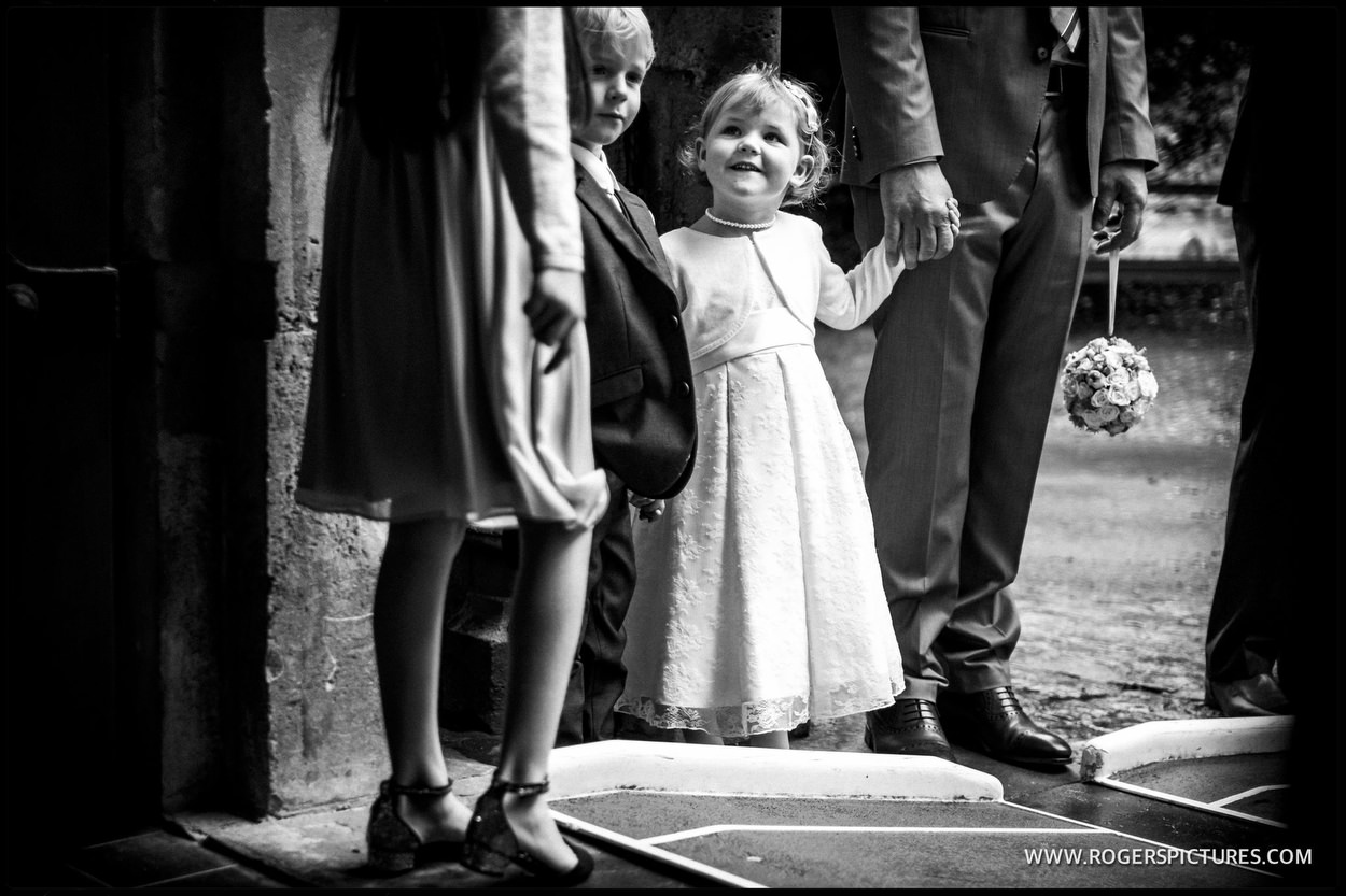 Children wait in church doorway for brides arrival