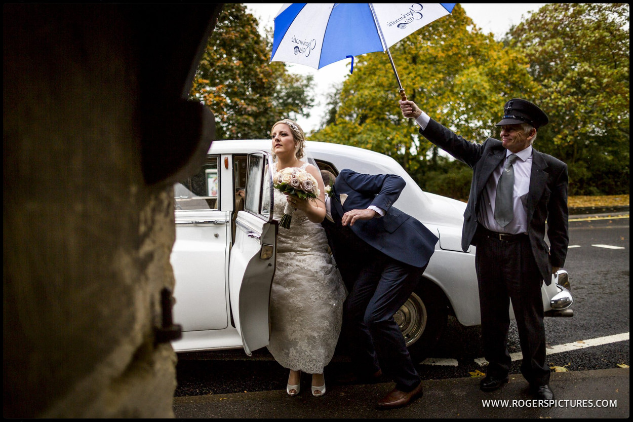 Bride arrives in the rain