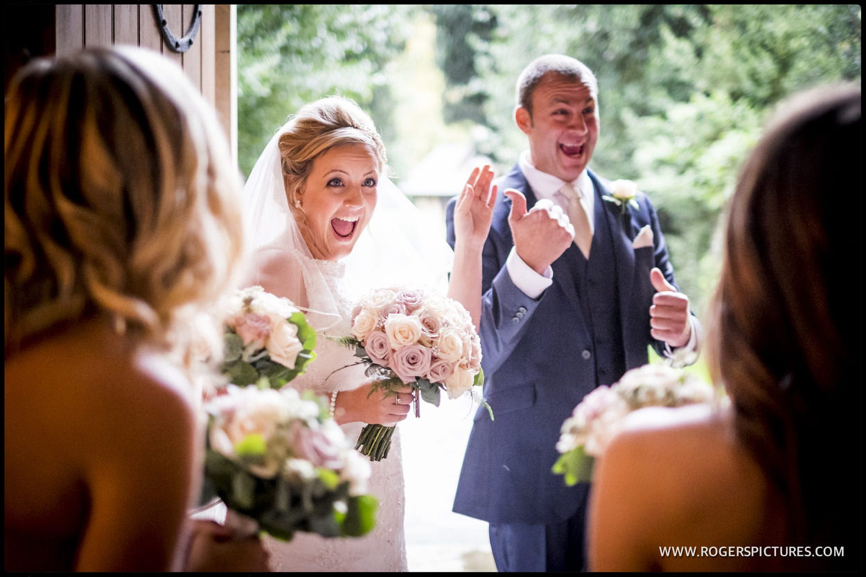 Happy bride is greeted at church door
