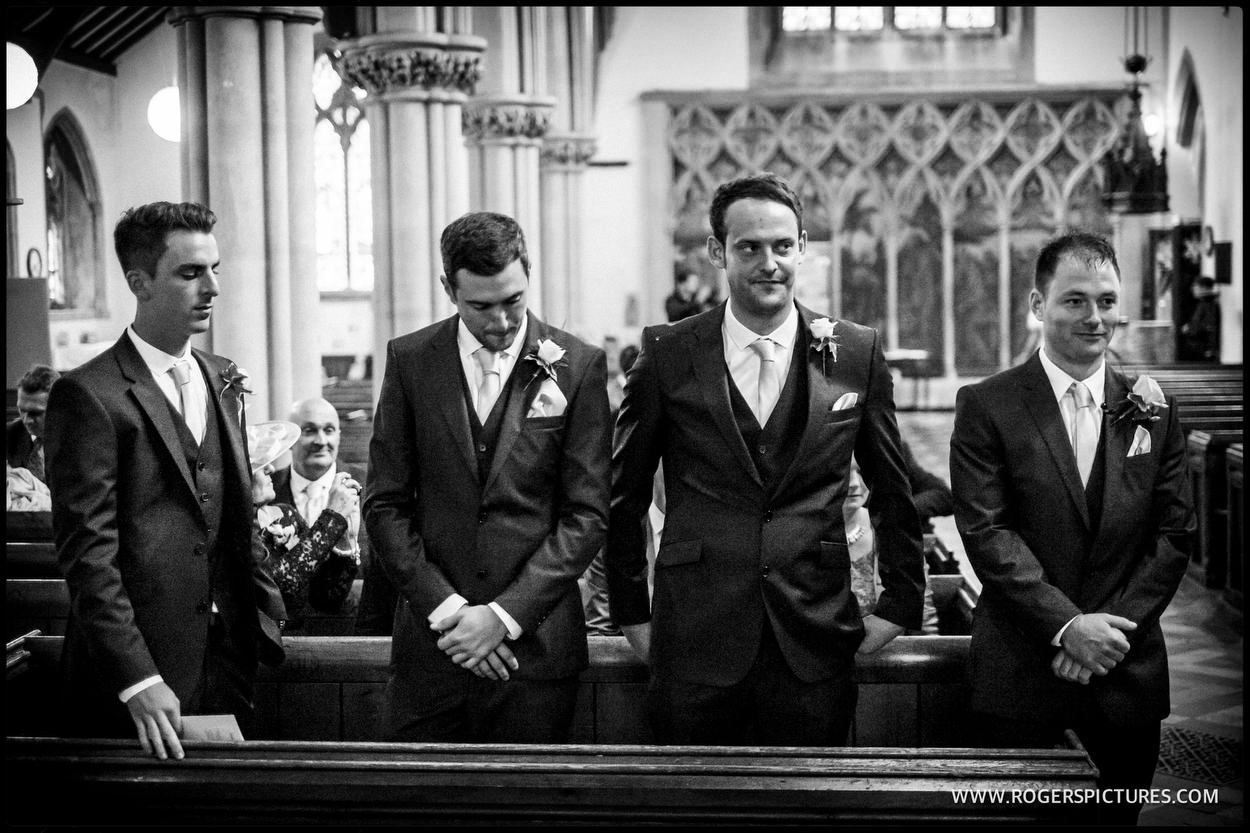 Groom and groomsmen wait nervously in church