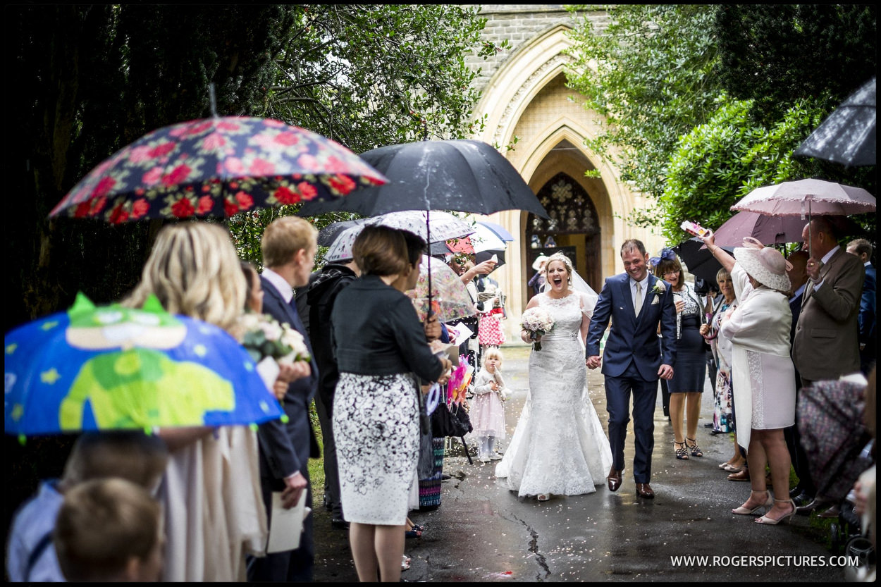 Husband and wife leave church in the rain