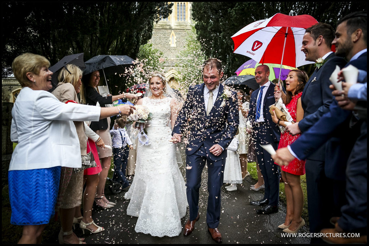 Raining confetti outside church wedding