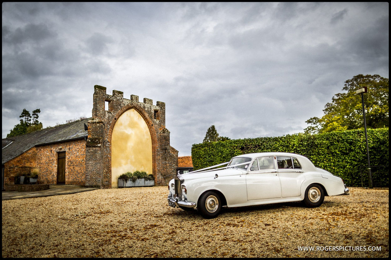 Rolls-Royce wedding car under rainy skies at Wasing park