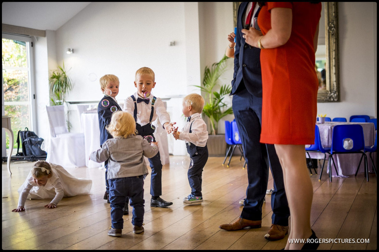 Children blowing bubbles at a wedding