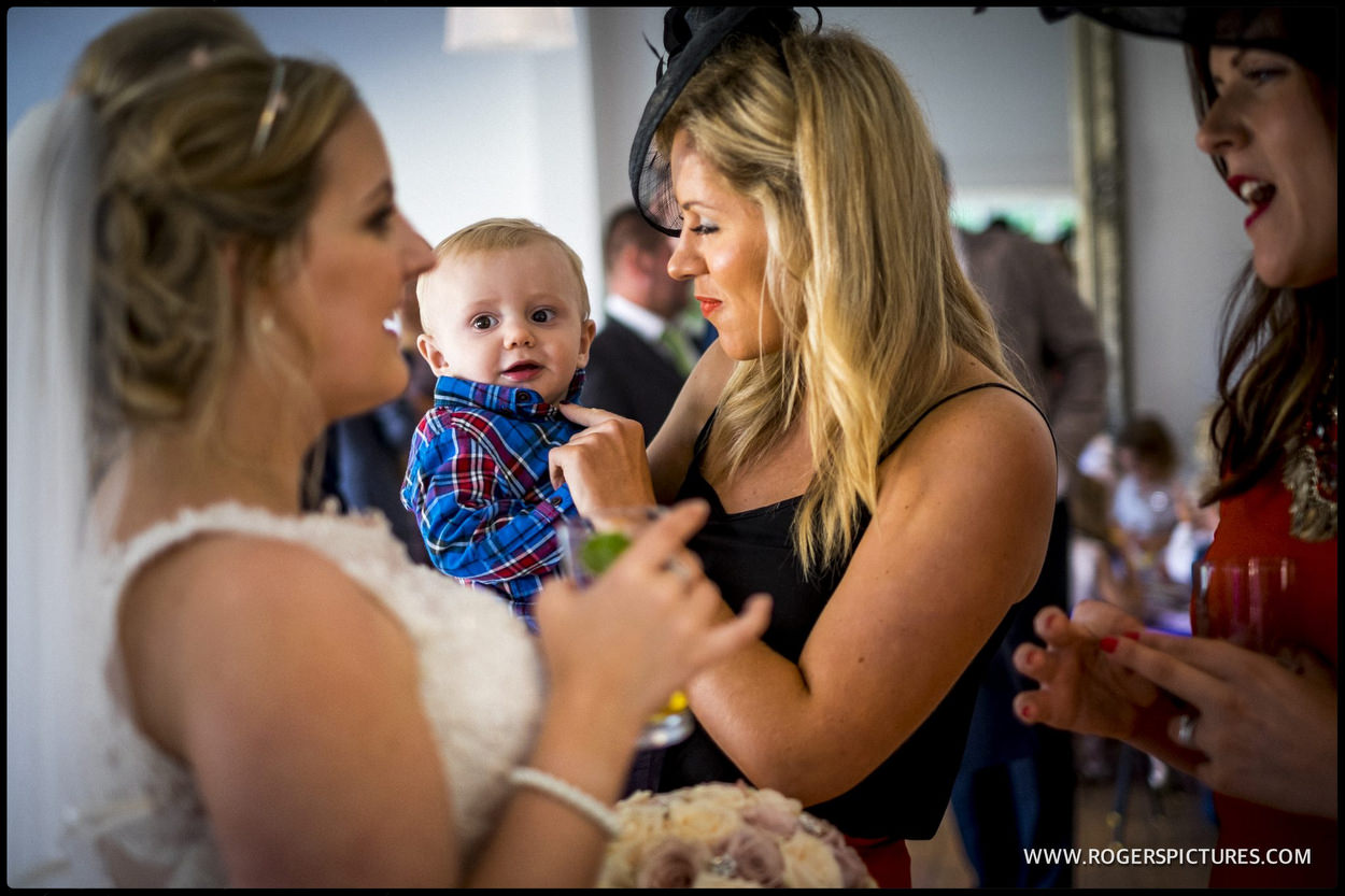Guest with baby at wedding