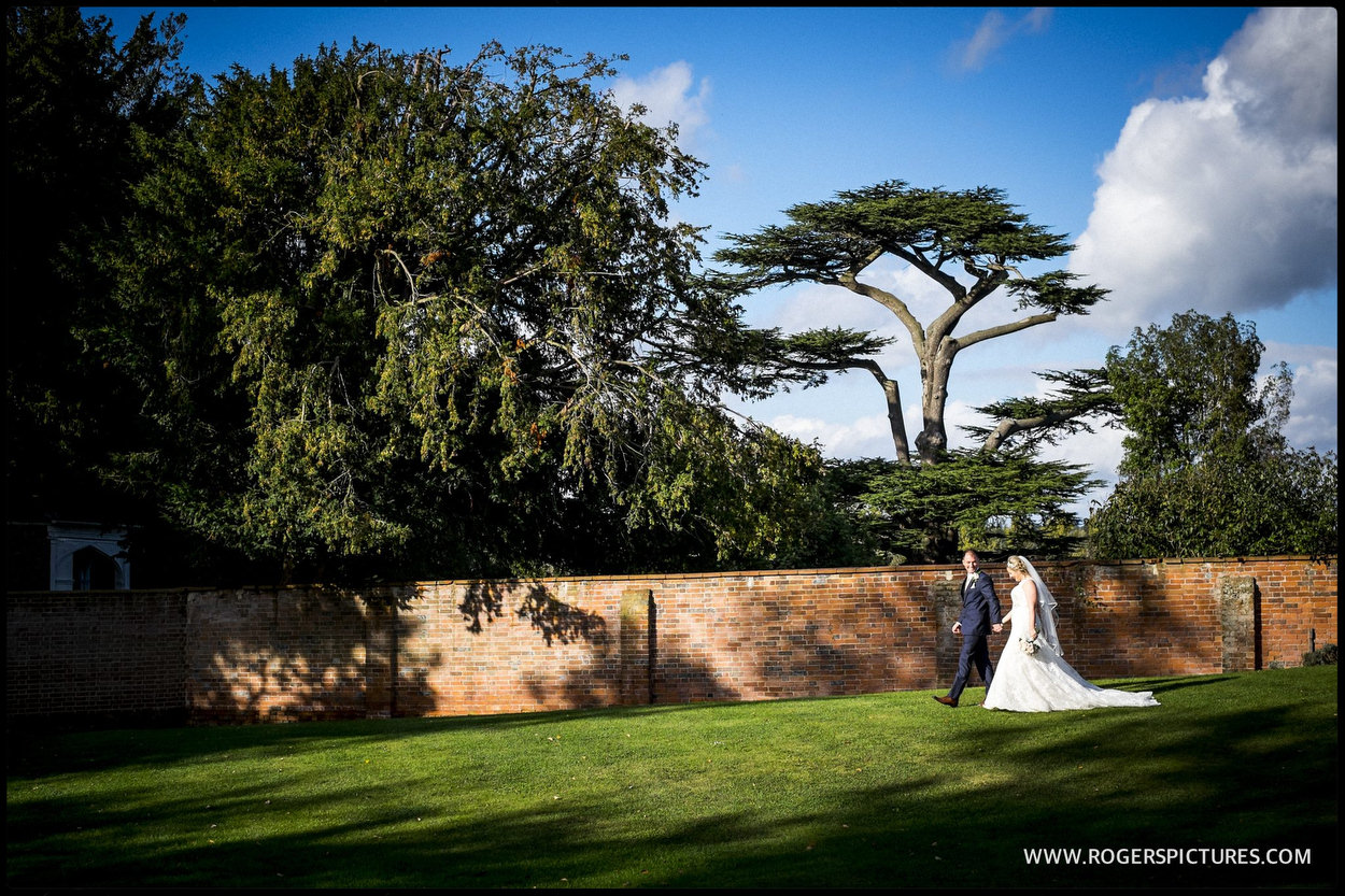Couple walking through the garden after wedding ceremony