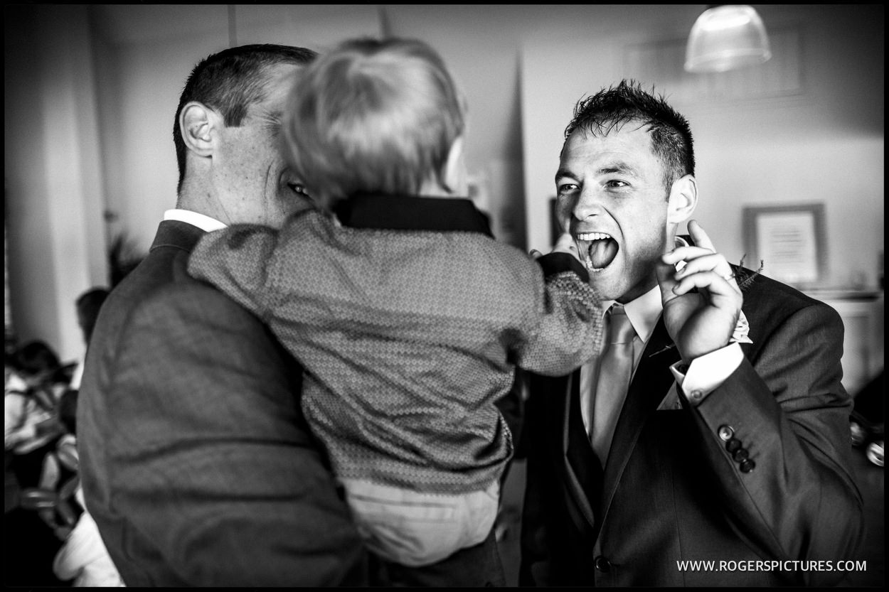 Guests laughing at wedding ceremony