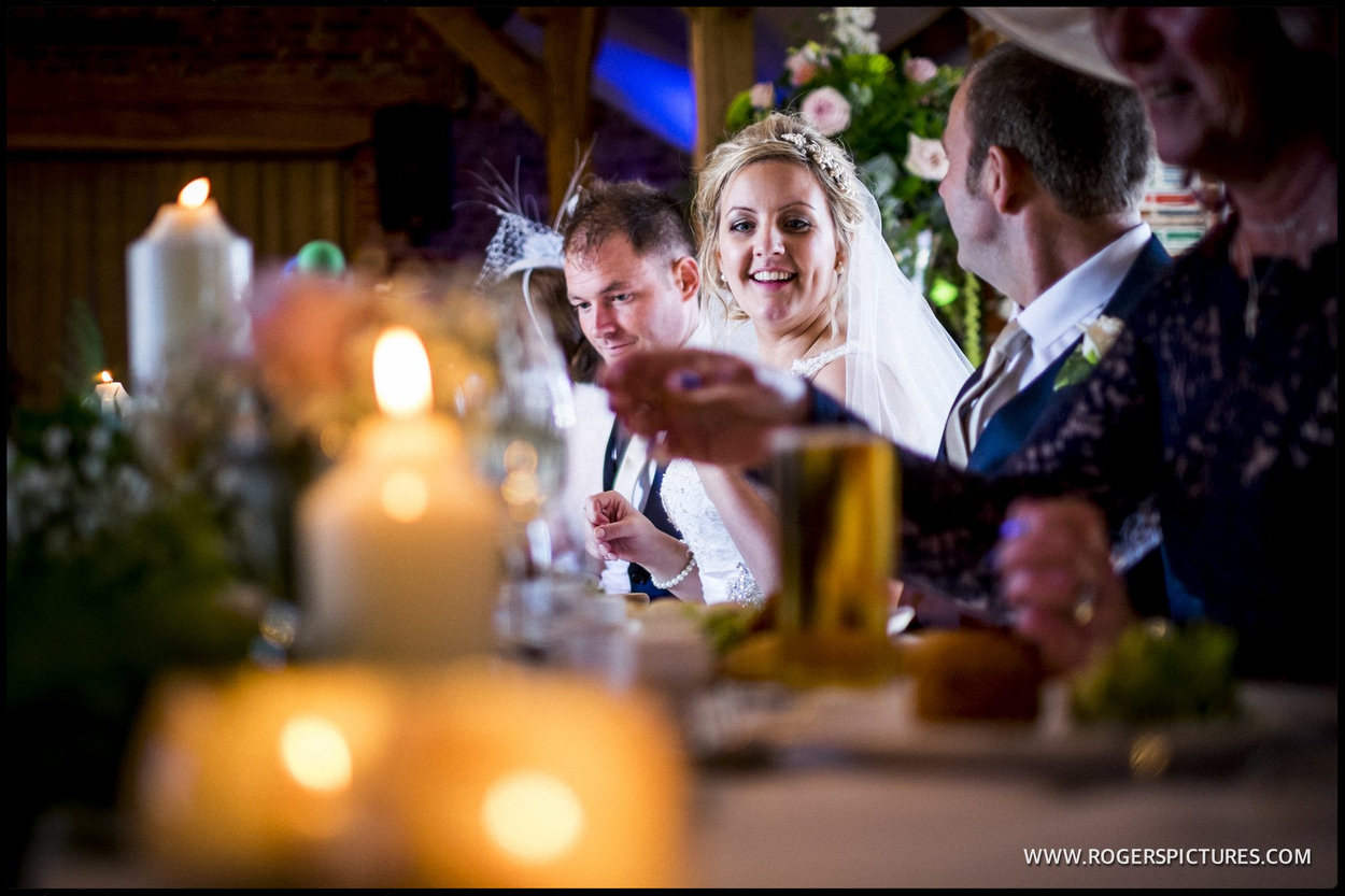 Bride and groom sitting at the top table at a wedding