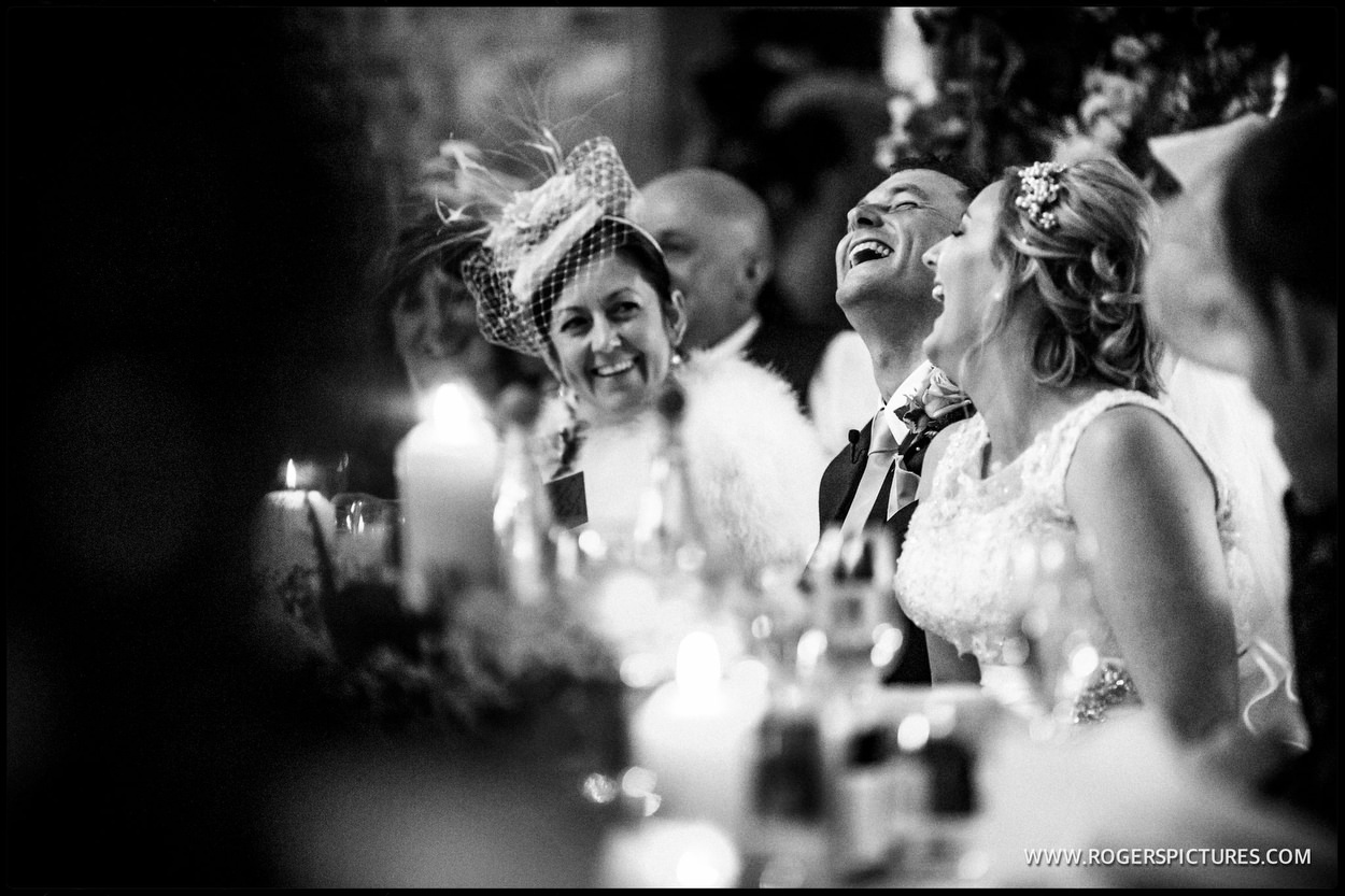 Black and white wedding picture of Mother enjoying speeches
