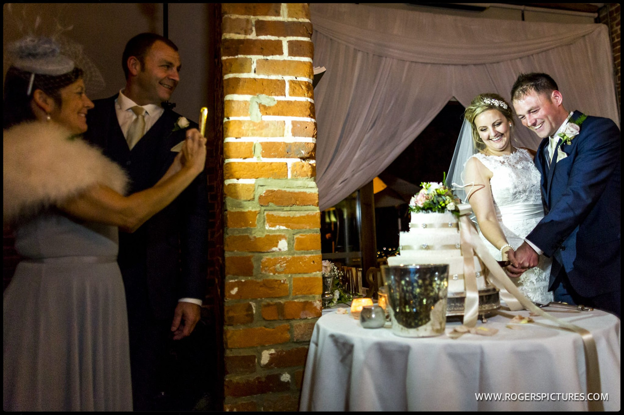 Couple cut the wedding cake
