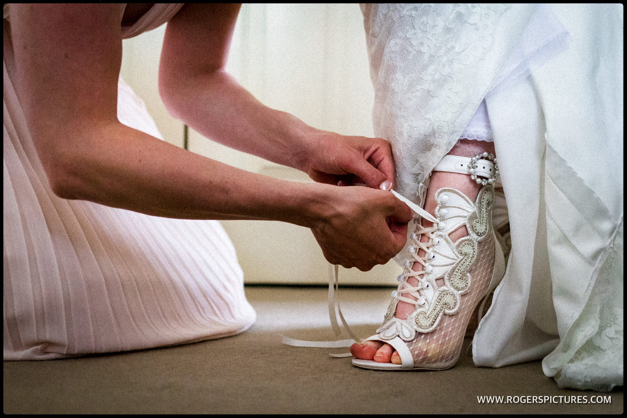 Bride having shoe laser up