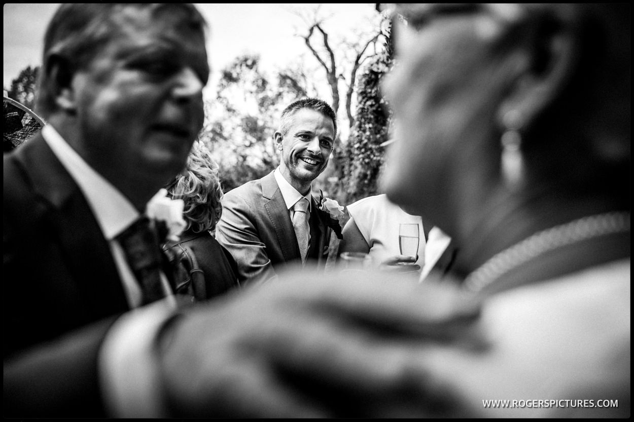 Groom being congratulated after wedding ceremony