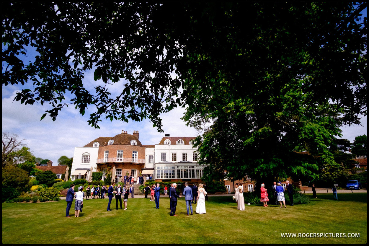 Guests outside St Albans Hotel wedding