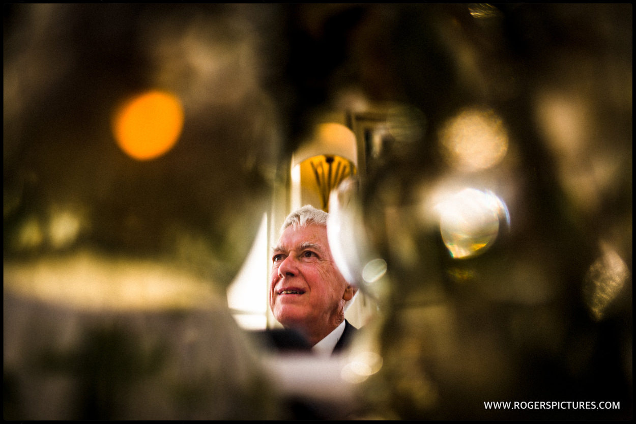 Father of the groom reflected in a mirror during speeches