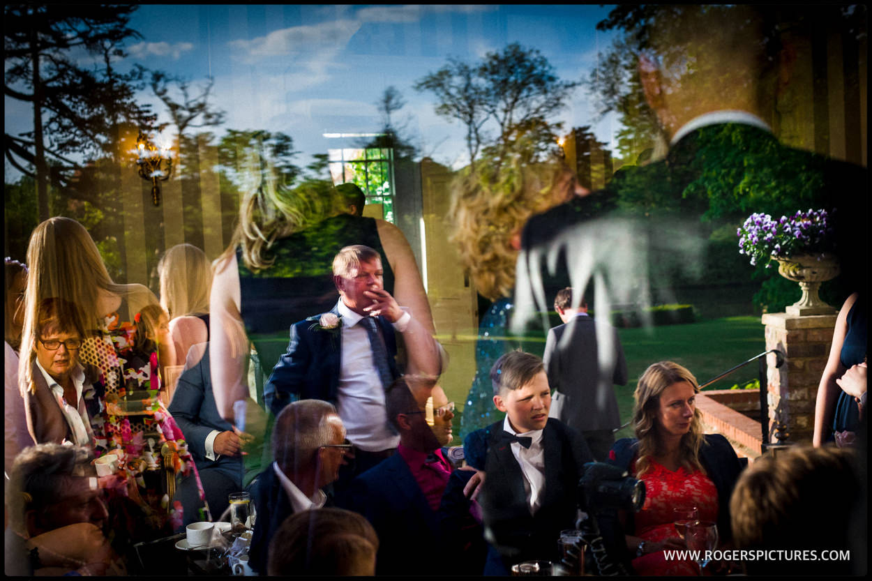 Complex scene through window reflection at a wedding in St Albans
