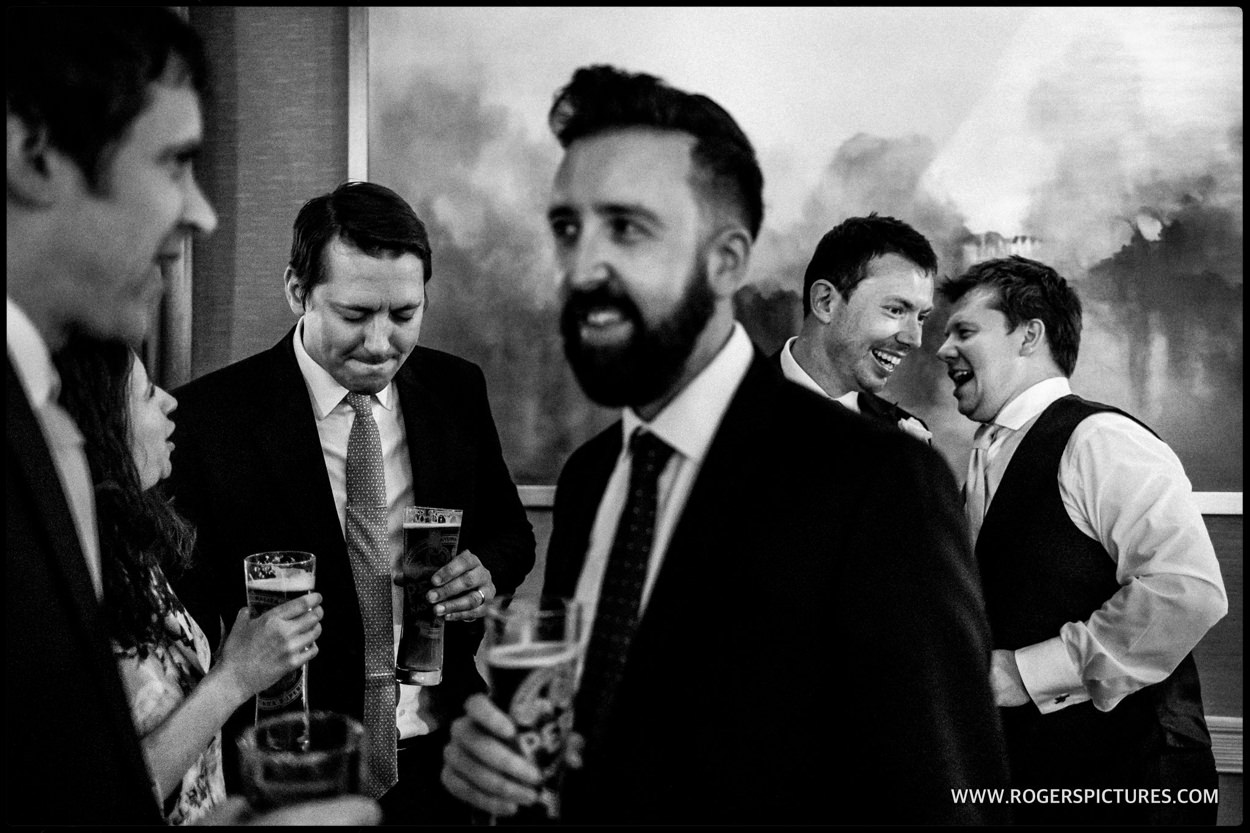 Documentary wedding photograph of guests in St Albans
