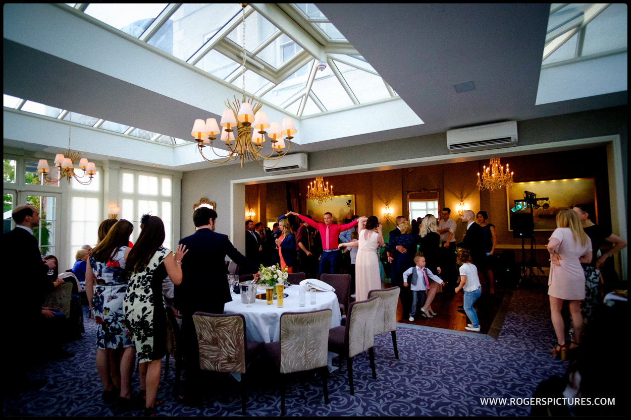 Wide shot of the dancefloor at a wedding at St Michael's Manor Hotel