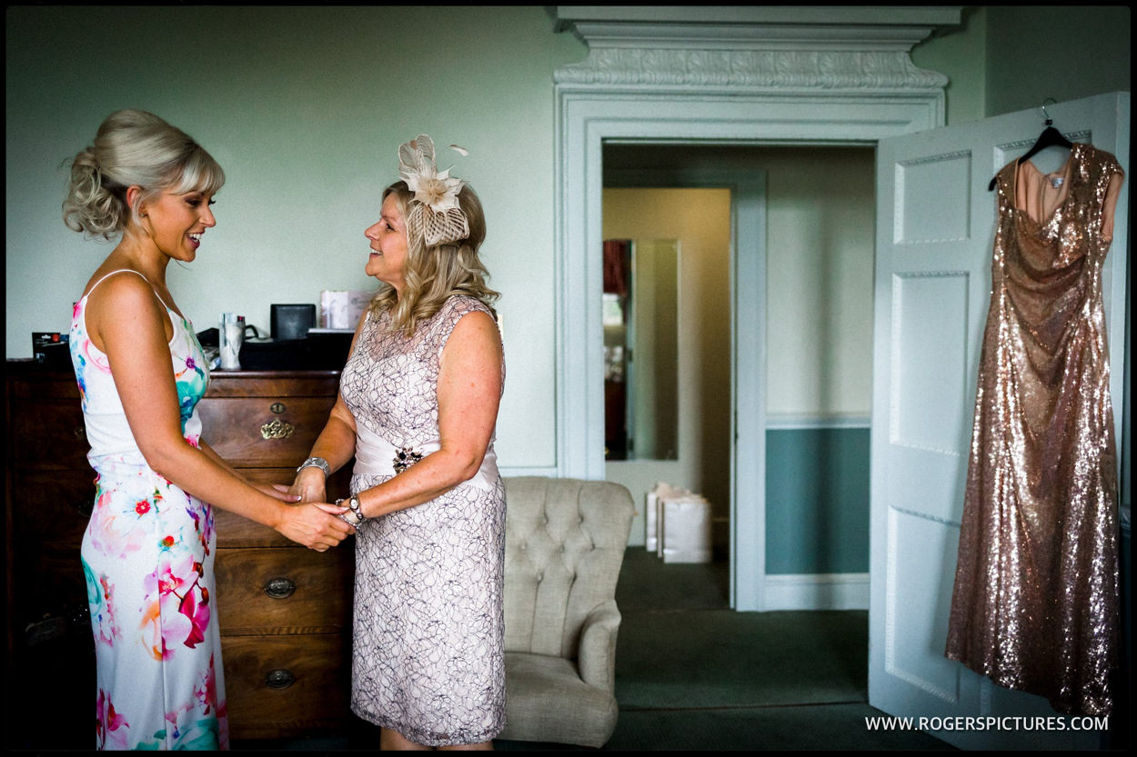 Bride and mother greet during wedding preparations