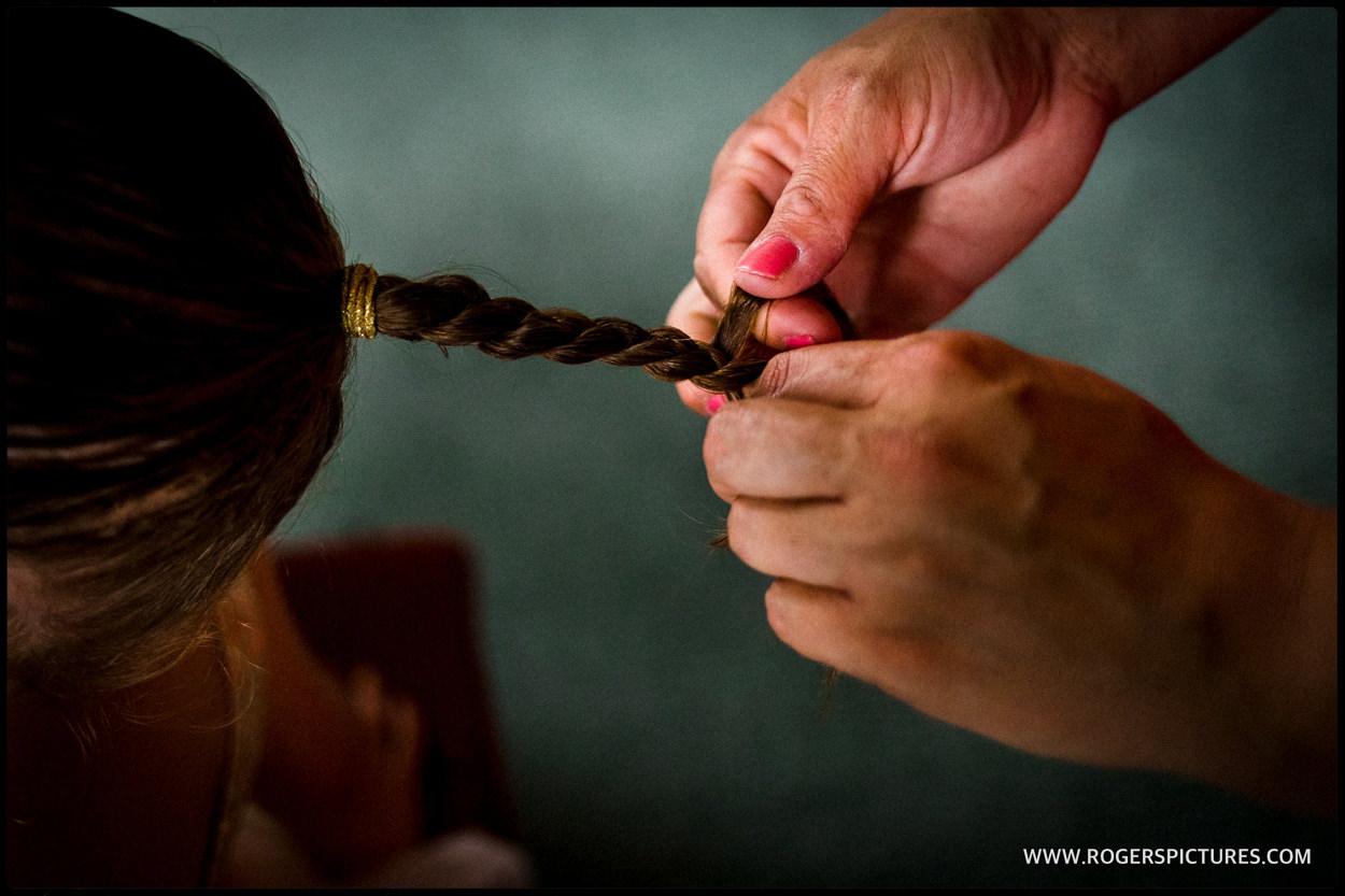 Flower girl has her hair plaited
