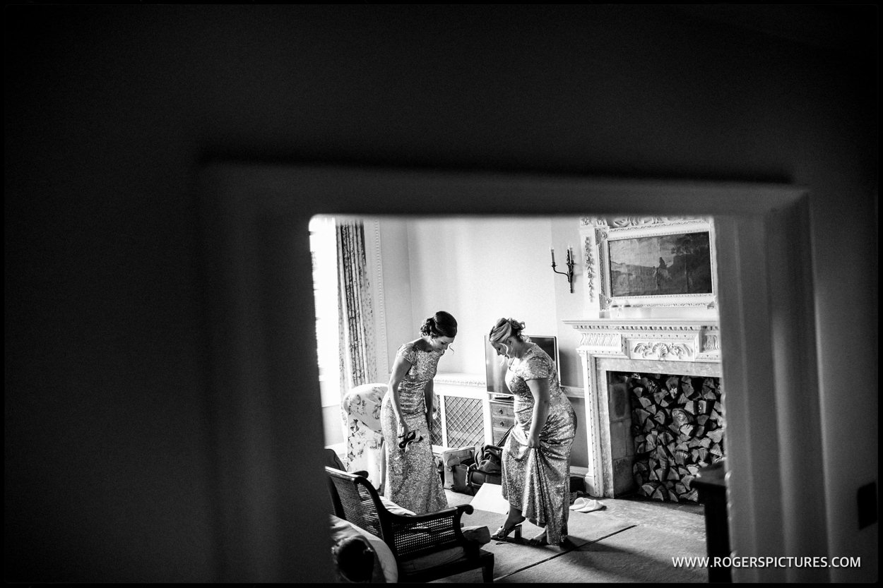 Bridesmaids prepare for the wedding ceremony
