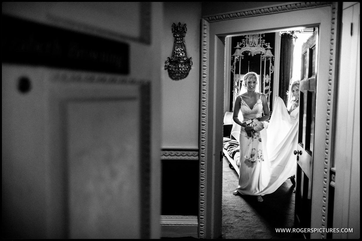Bride backlit in her wedding dress