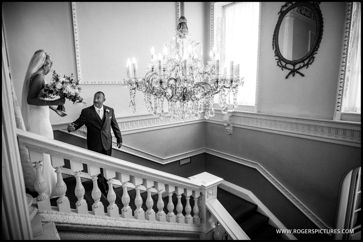 Father and Bride walked down the stairs at Buxted Park