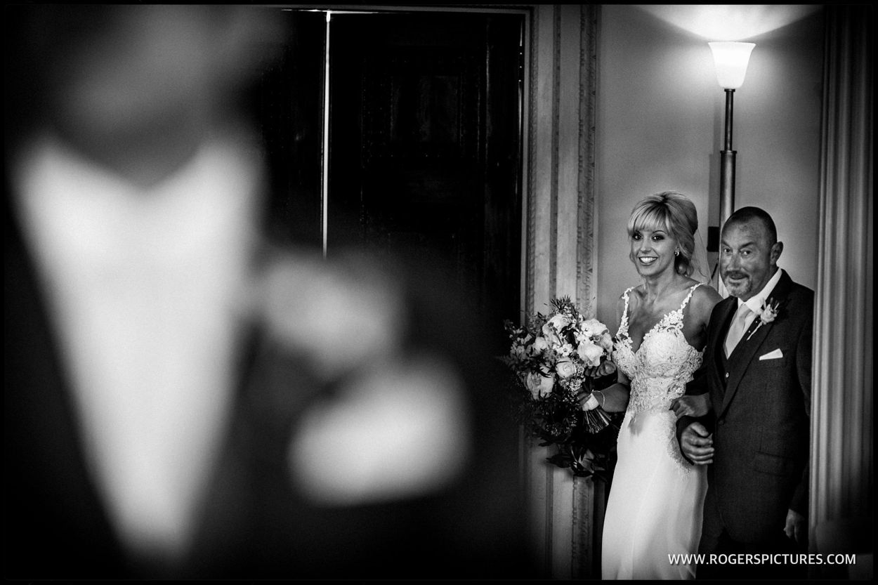 Wedding photojournalism showing bride and father entering the ceremony