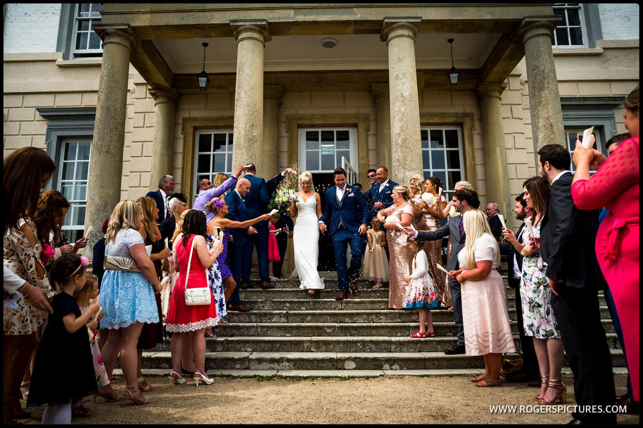 Newly married couple on the steps at Buxted Park