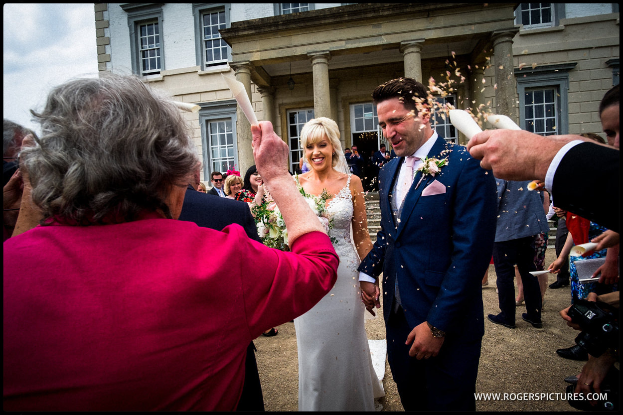 Couple and confetti at Buxted Park