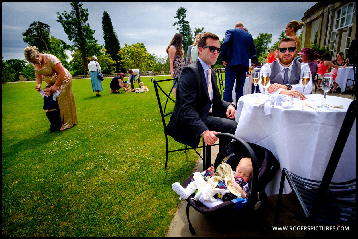Family and friends enjoy outdoor reception at Buxted Park