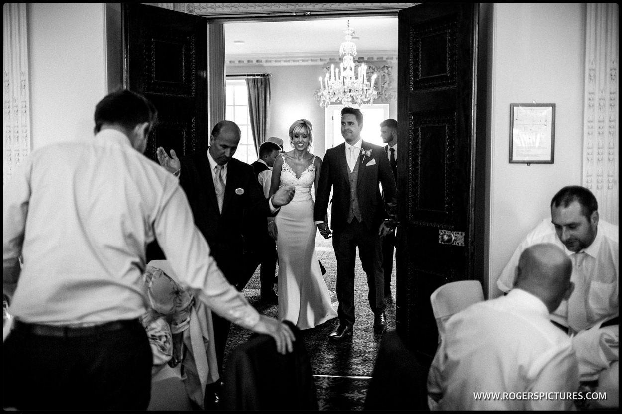 Couple enter wedding breakfast