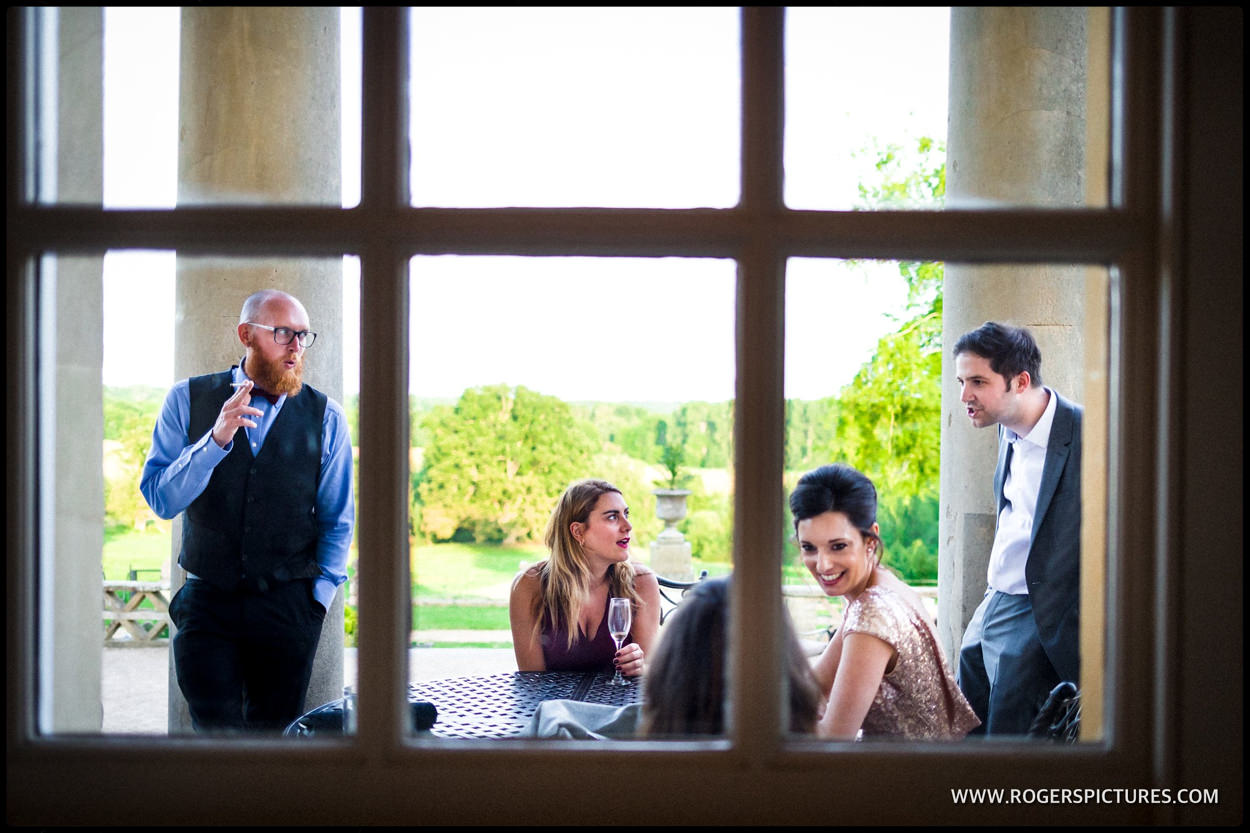 Friends framed in windowpanes during wedding