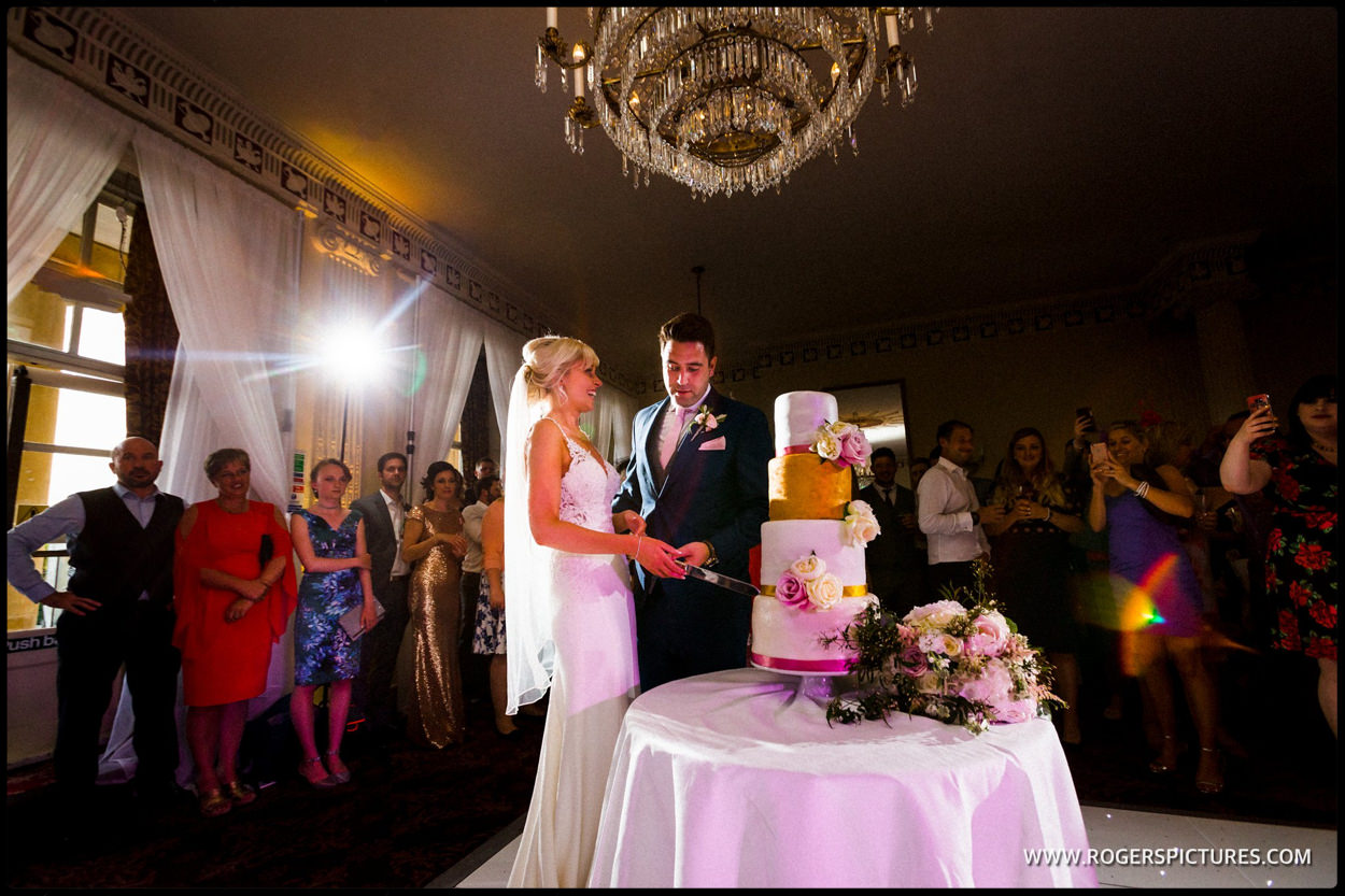 Wedding cake cut at Buxted Park