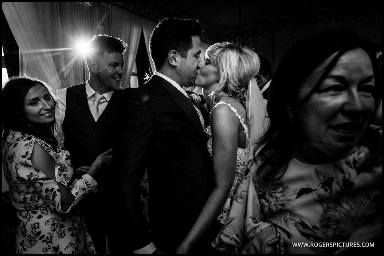 Husband and wife kiss on the dancefloor