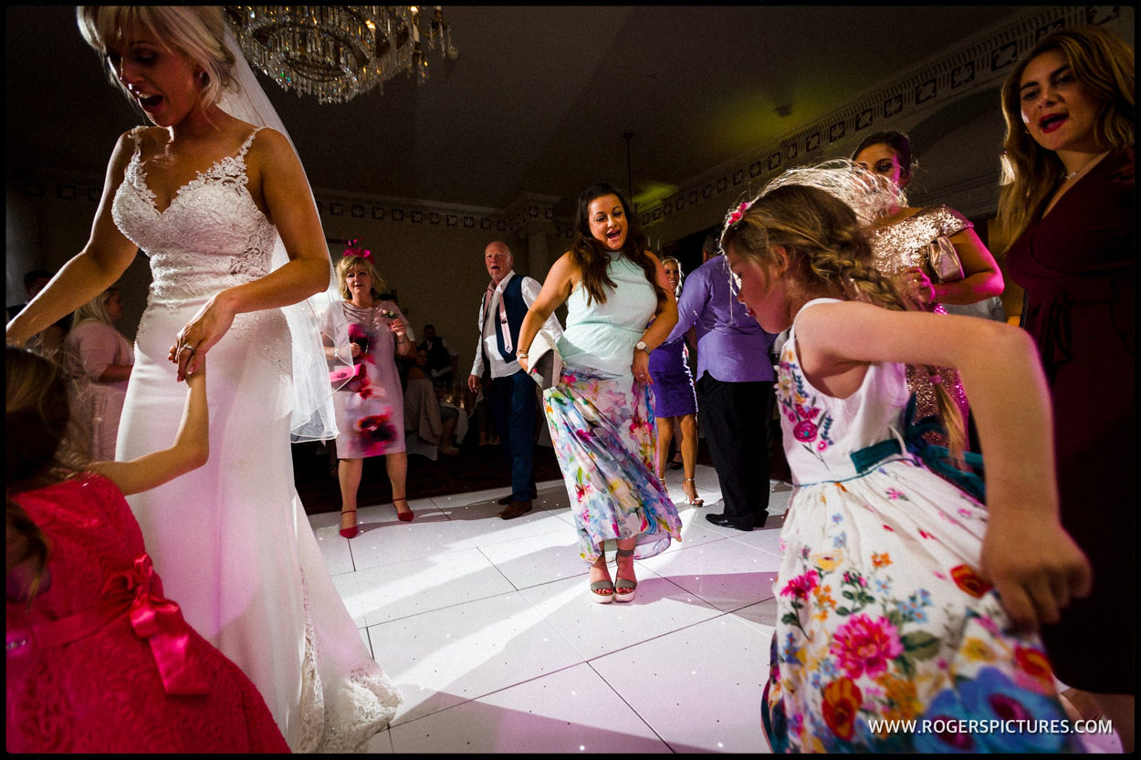 Friends dancing at Buxted Park wedding